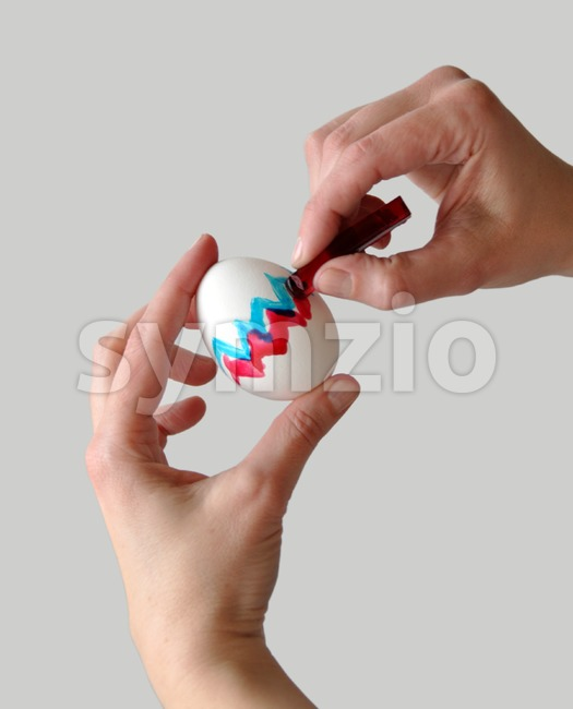 Coloring easter egg Stock Photo