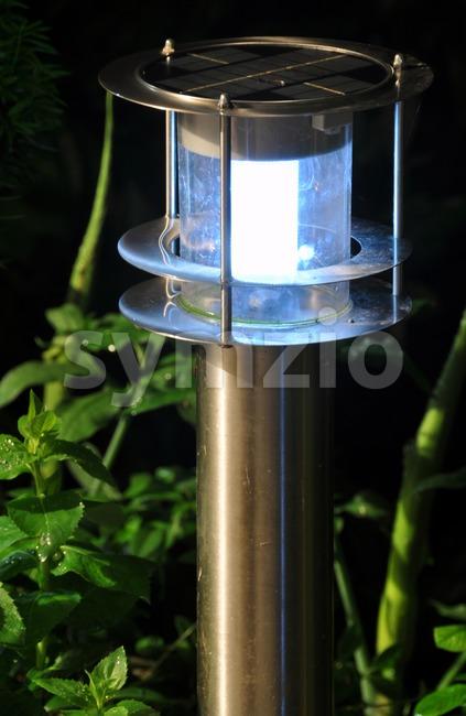 Solar garden lamp at night Stock Photo