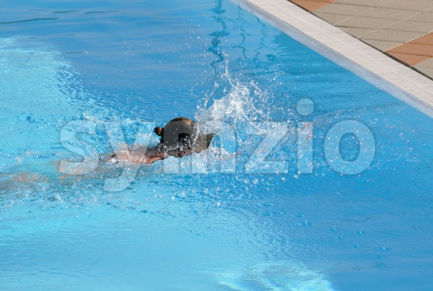 Female swimming the crawl Stock Photo