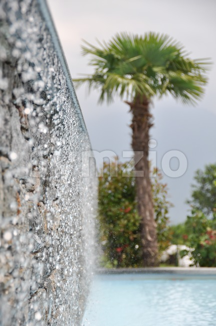 Swimming pool and waterfalls Stock Photo