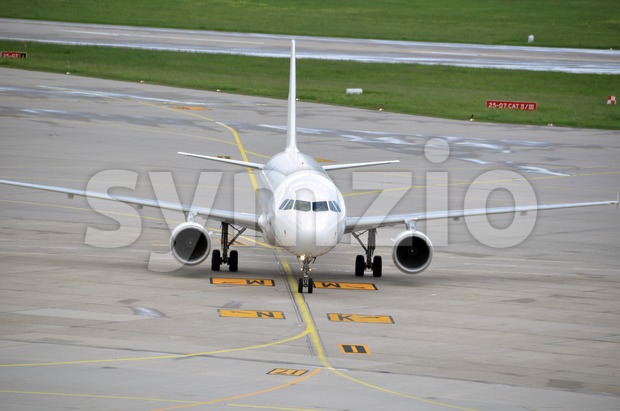 Airplane taxiing at large airport Stock Photo