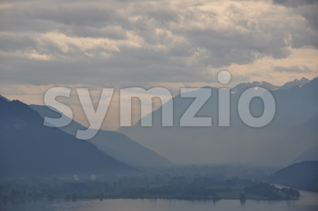 View over Lake Como (Italy) with great early morning mist and impressive clouds
