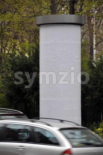 Advertising pillar with traffic Stock Photo