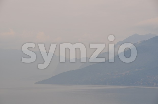 Lake Como in early morning mist 2 Stock Photo