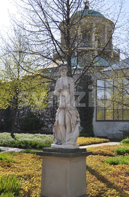 Ancient stone bust in park of Stuttgart palace with art museum in the background