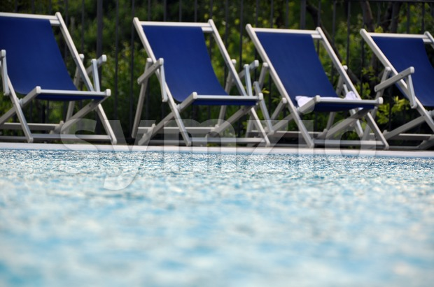 Swimming Pool chairs Stock Photo