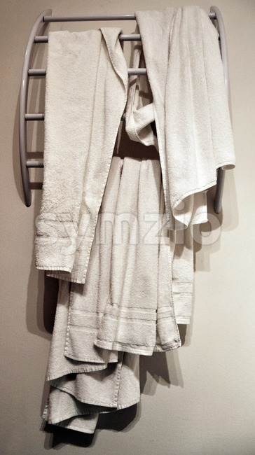Used hotel  towels on modern rack Stock Photo