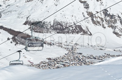 Chairlifts with mountain village Stock Photo