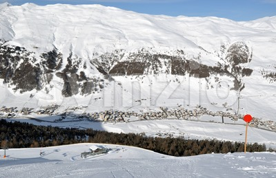 View down ski slope on chairlift station, valley and impressive mountains Stock Photo