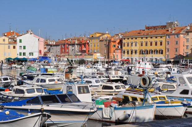 Numerous small boats waiting in Croatian marina of Rovinj