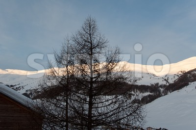 Sunrise in snowy Italian alps Stock Photo