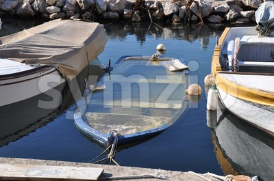 Sinking fisherboat Stock Photo