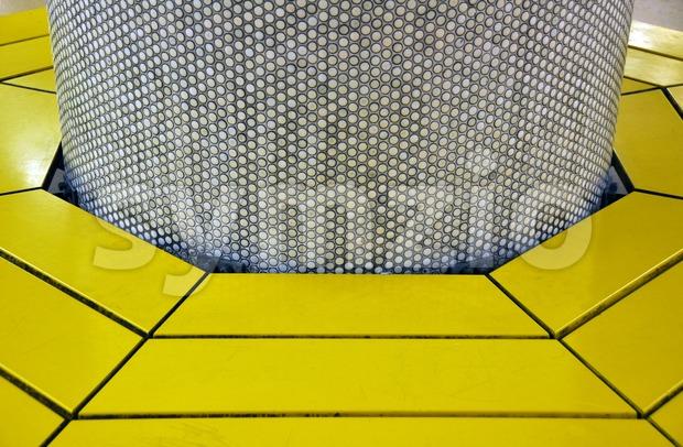 Bench around pillar Stock Photo