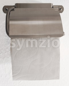 Toilet roll holder with toilet paper on white Stock Photo