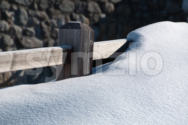 Fence covered by powder snow Stock Photo