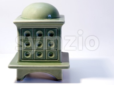 Miniature model of a tiled stove on white Stock Photo