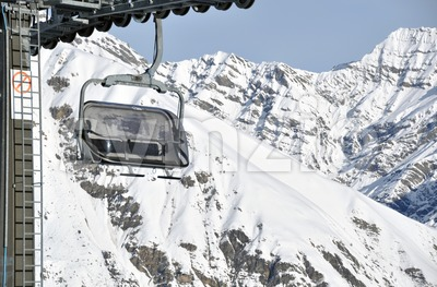 Chairlift and mountains Stock Photo