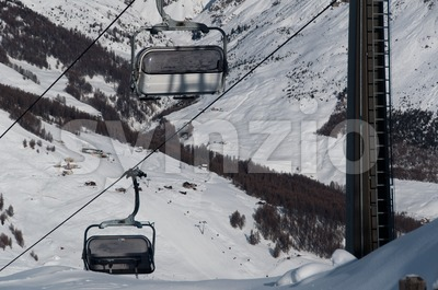 Chairlifts with ski slopes Stock Photo