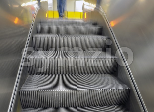 Escalator moving down Stock Photo