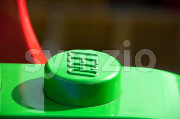 Huge Lego logo on a plastic car ride Stock Photo
