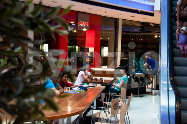 People sitting in shopping mall in Stuttgart, Germany Stock Photo