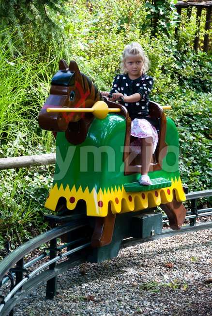 Girl playing knight at Legoland Stock Photo