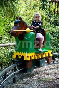 Girl playing knight at Legoland Stock Photo