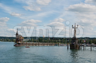Imperia statue and old building at the harbor of Konstanz Stock Photo