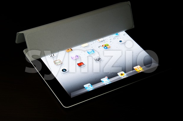 Stuttgart ,Germany –March 27, 2011: A black Wi-Fi iPad2 with gray Smart Cover – the Smart Cover is partly opened ...