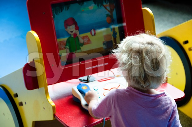 Child playing at a learning computer Stock Photo