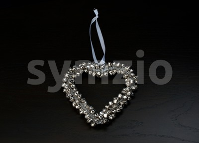 decoration: silver bells forming a heart Stock Photo