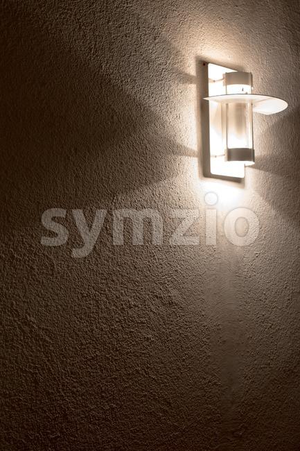 Modern lamp on concrete wall Stock Photo