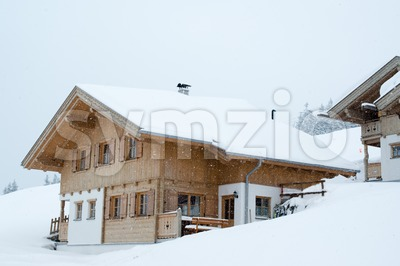 Beautiful skiing hut in deep snow Stock Photo