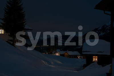 Ski village with chapel at night Stock Photo