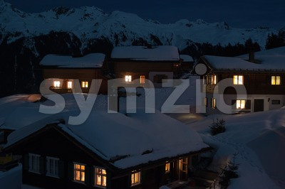 Ski village at night with mountains Stock Photo