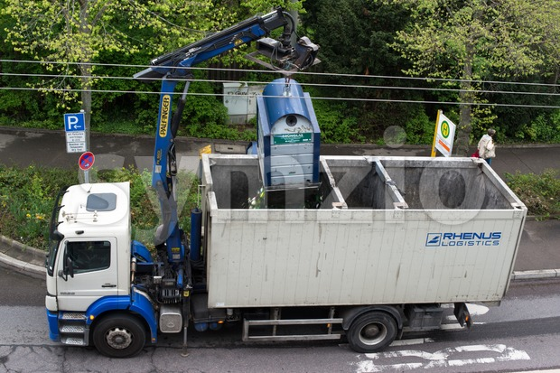 Van emptying glass recycling container Stock Photo