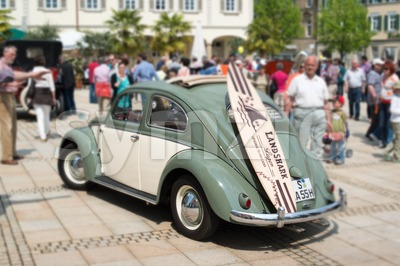 VW Beetle Classic Car with Surfboard Stock Photo