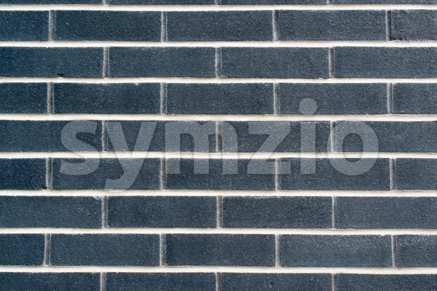 Modern dark brick wall background or texture