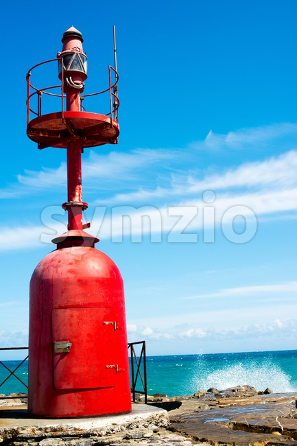 Small red lighthouse Stock Photo