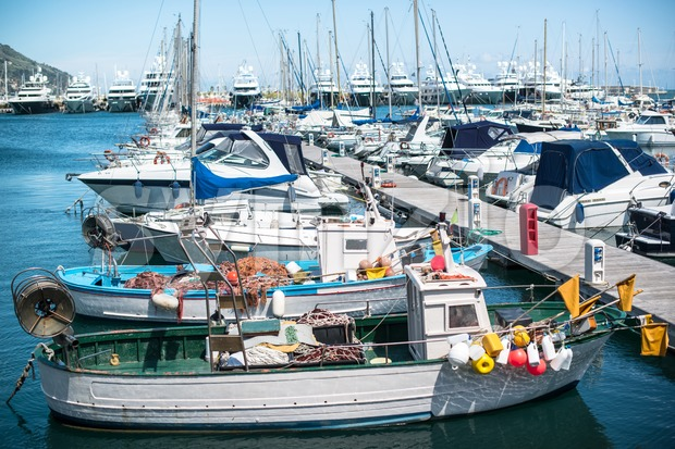 Various boats at rest in the marina Stock Photo