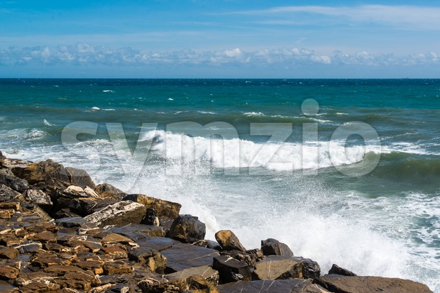 Waves hitting the rocks Stock Photo