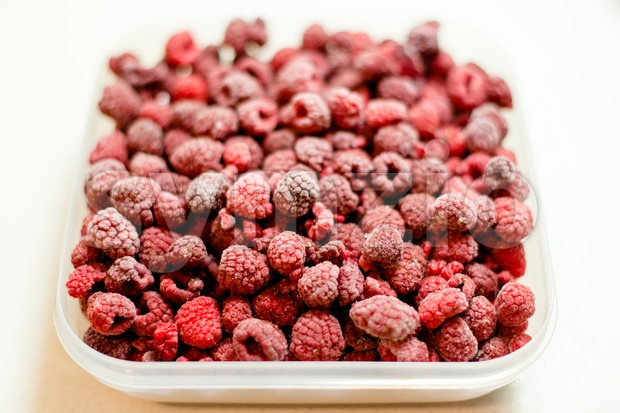 frozen raspberries Stock Photo