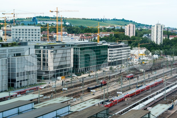 STUTTGART, GERMANY - June 15, 2013:  Stuttgart main railway station and incoming trains with Stuttgart 21 construction site on ...