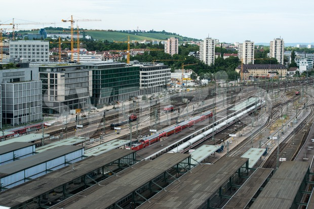 STUTTGART, GERMANY - June 15, 2013: Stuttgart main railway station and incoming trains with Stuttgart 21 construction site on June ...