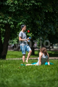 Young man juggling in the park Stock Photo