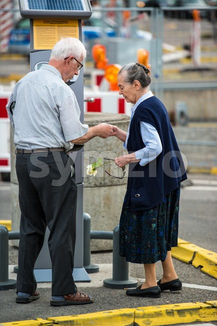 Senior couple at ticket machine outdoor Stock Photo