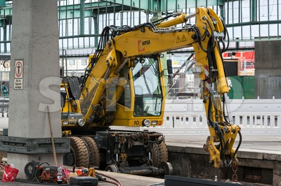 Rail excavator at Stuttgart main railway station - S21 Stock Photo