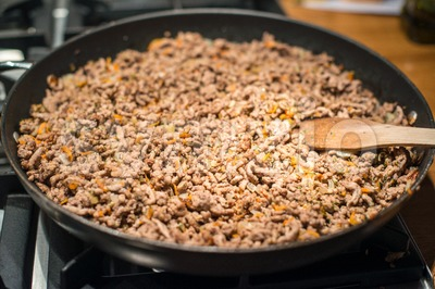 Minced meat in frying pan Stock Photo