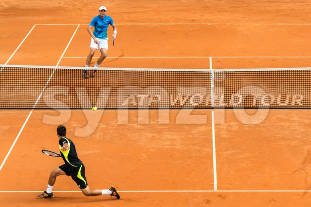 STUTTGART, GERMANY -July 7, 2013: German tennis player Andreas Beck (blue and white cap) is challenging Damir Džumhur (black with ...