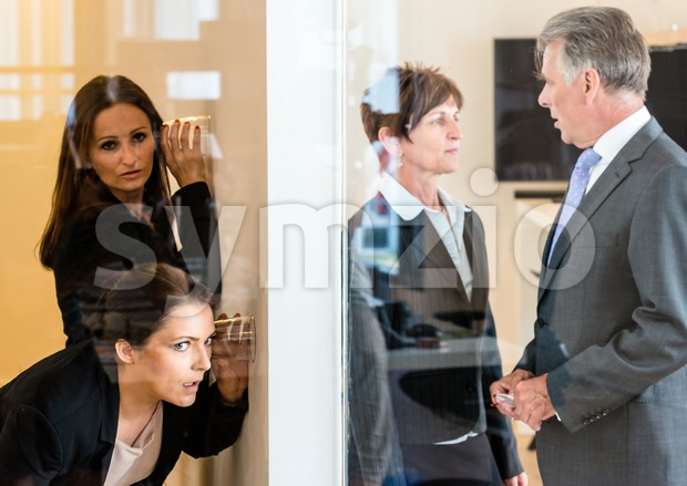 eavesdropping in the office Stock Photo